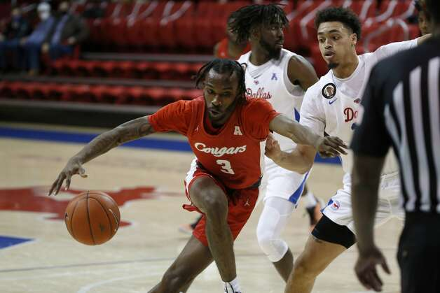 Houston guard DeJon Jarreau (3) drives to the basket while SMU forward Ethan Chargois (25) defends during the first half of an NCAA college basketball game in Dallas, Sunday, Jan. 3, 2021. (AP Photo/Roger Steinman) Photo: Roger Steinman/Associated Press / Copyright 2021 The Associated Press. All rights reserved.