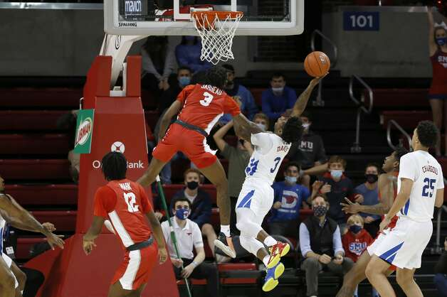 SMU guard Kendric Davis (3) takes a shot while Houston guard DeJon Jarreau (3) attempts a block during the first half of an NCAA college basketball game in Dallas, Sunday, Jan. 3, 2021. (AP Photo/Roger Steinman) Photo: Roger Steinman/Associated Press / Copyright 2021 The Associated Press. All rights reserved.