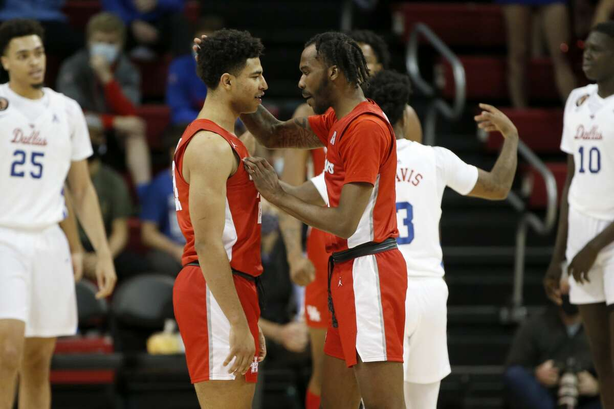 Houston guard DeJon Jarreau, right, and guard Quentin Grimes, left, meet on the court after a foul in the second half of an NCAA college basketball game against SMU in Dallas, Sunday, Jan. 3, 2021. (AP Photo/Roger Steinman)