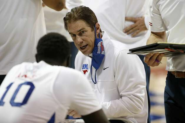 SMU head coach Tim Jankovich talks to his players during a timeout in the second half of an NCAA college basketball game against Houston in Dallas, Sunday, Jan. 3, 2021. (AP Photo/Roger Steinman) Photo: Roger Steinman/Associated Press / Copyright 2021 The Associated Press. All rights reserved.