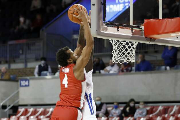 Houston forward Justin Gorham (4) attempts a dunk over the defense of SMU forward Yor Anei, background, during the first half of an NCAA college basketball game in Dallas, Sunday, Jan. 3, 2021. (AP Photo/Roger Steinman) Photo: Roger Steinman/Associated Press / Copyright 2021 The Associated Press. All rights reserved.