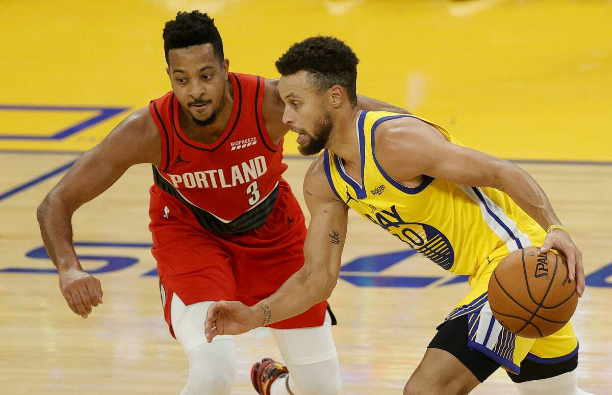 Stephen Curry of the Golden State Warriors is guarded by CJ McCollum #3 of the Portland Trail Blazers at Chase Center on Jan. 3, 2021 (Photo by Ezra Shaw/Getty Images)
