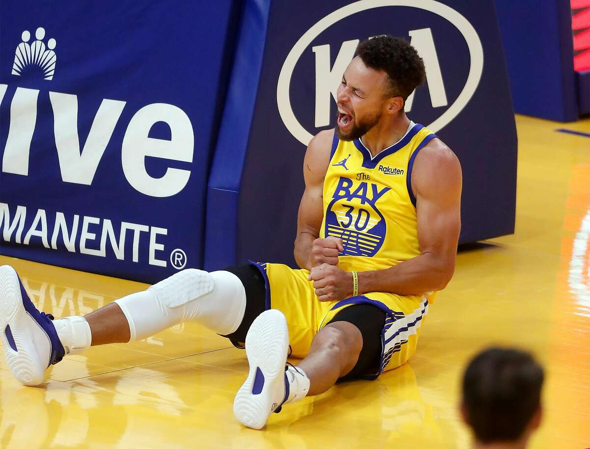 Stephen Curry reacts to drawing a foul against Portland in the first quarter Sunday at Chase Center.