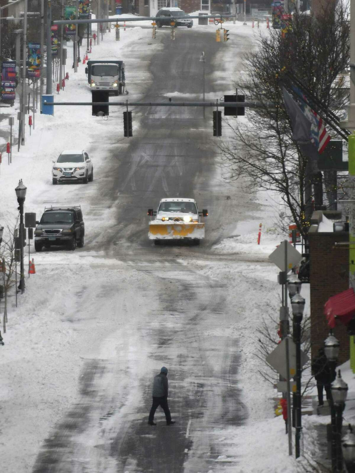 A file photo of a snow-covered street in Stamford, Conn., taken Thursday, Dec. 17, 2020. The city mainly saw rain during a storm that hit the state Sunday, Jan. 3, 2021.