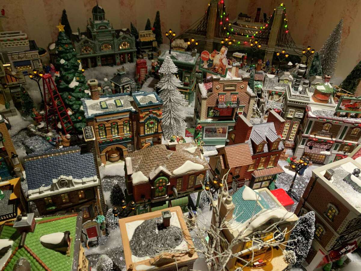 Every year, resident Charlene Sarris sets up her large collection of custom-made houses and accessories in her living room. This year's themed village is Christmas in the City.