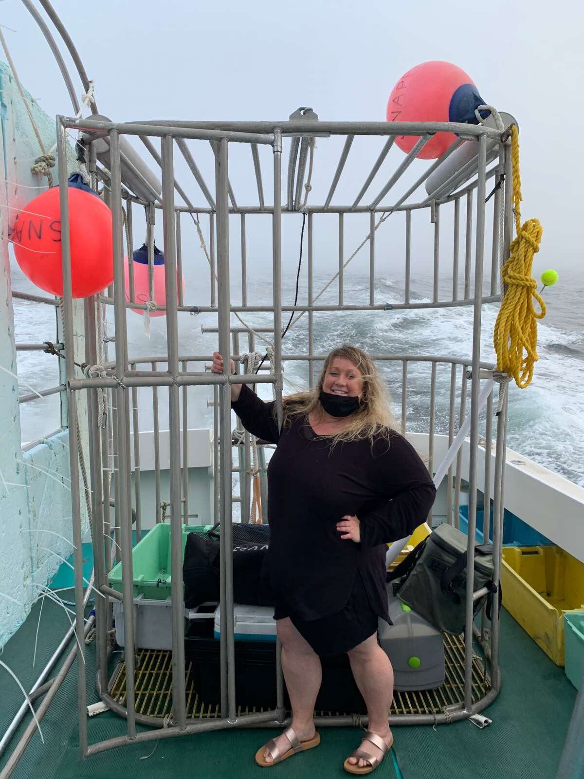 Writer Jessica Kelly on one of her solo trips, this time going diving for sharks in Newport, Rhode Island.