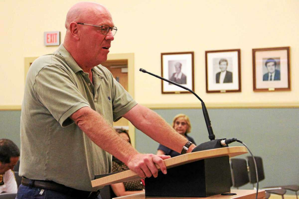 Robert Crovo, former tax collector for the city of Torrington, speaks during a meeting.