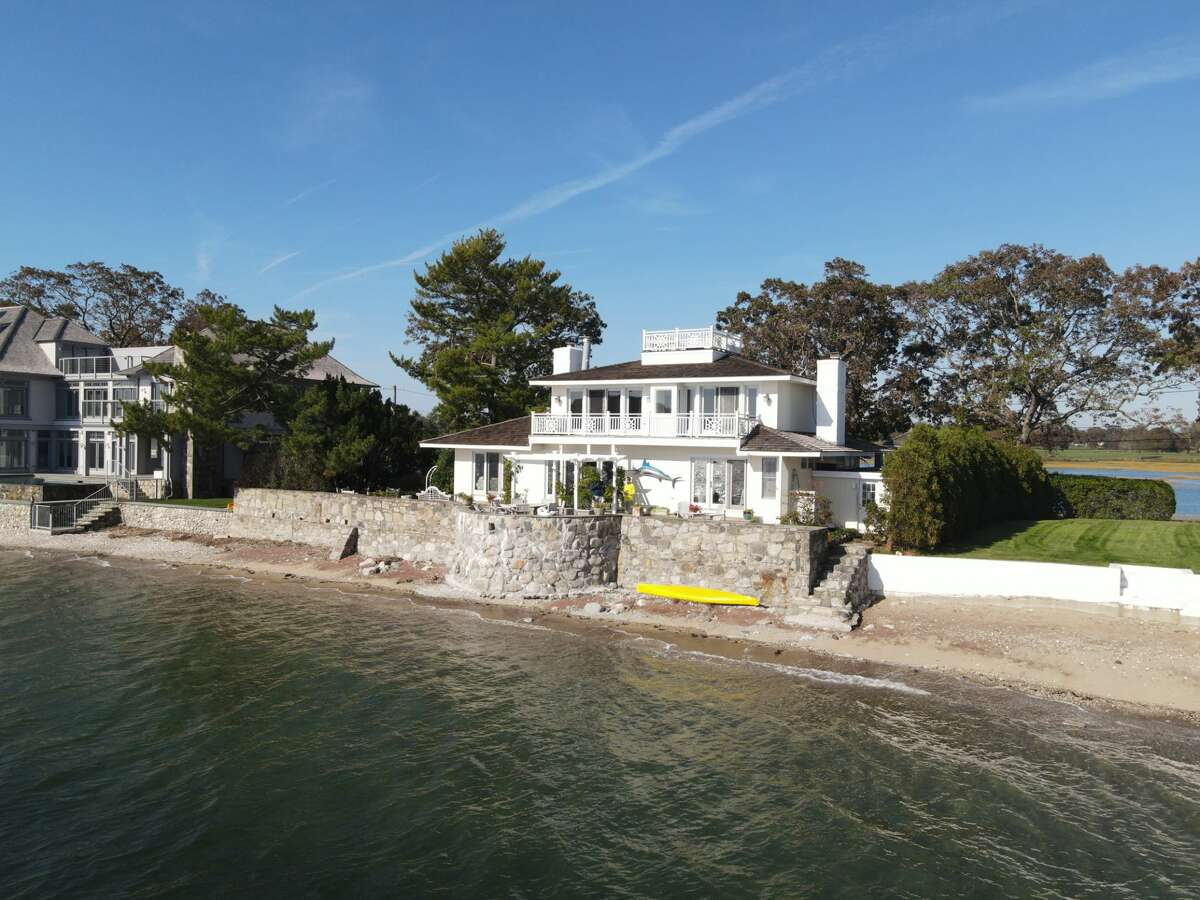 The house at 34 Shorehaven Road, Norwalk has a private beach and an in-ground swimming pool (not pictured). Access to the island is achieved with a gate code to cross the bridge, so traffic is limited and there are many days when you might not see anyone go by, Mickiewicz said. While private and protected, this property is not completely isolated.