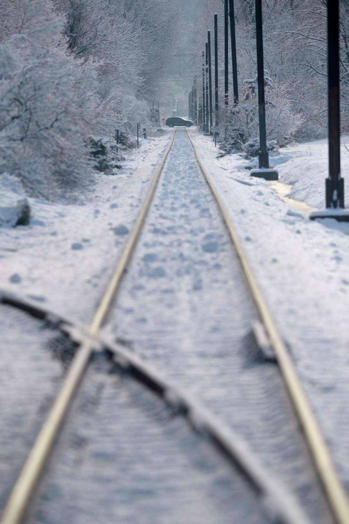 Snow covers the area along the Metro North tracks from Shelter Rock Road to Great Pasture Road. Monday, January 4, 2021, in Danbury, Conn.