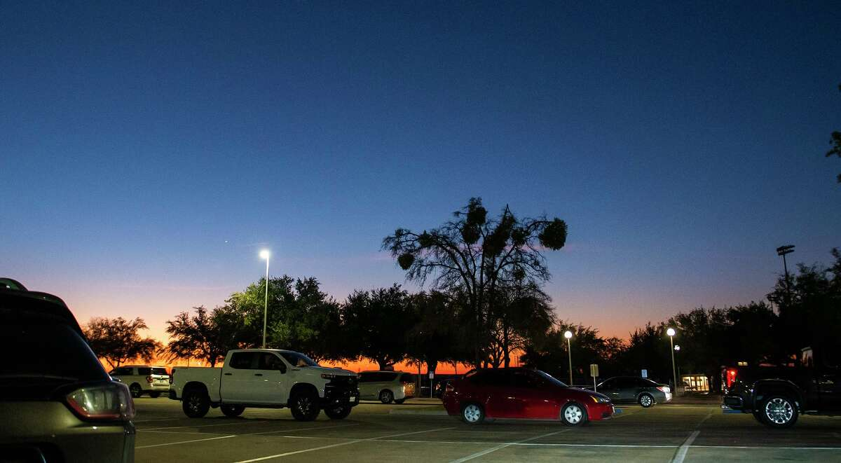 Laredoans line up receive the Moderna COVID-19 vaccine at dawn, hours before the start of the vaccine drive-thru for healthcare workers, senior citizens and those with medical conditions, Sunday at TAMIU.