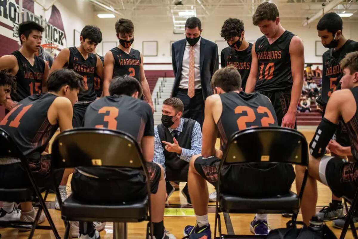 Westwood High School head basketball coach Brad Hastings speaks to his team during a time out at game. Hastings said many of his students have trained most of their lives, and it'd be a shame if the seniors didn't have the opportunity to play.