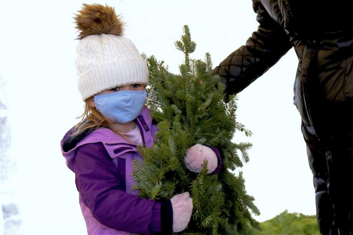 Mac Duff, 6, of Ridgefield totes her wreath.