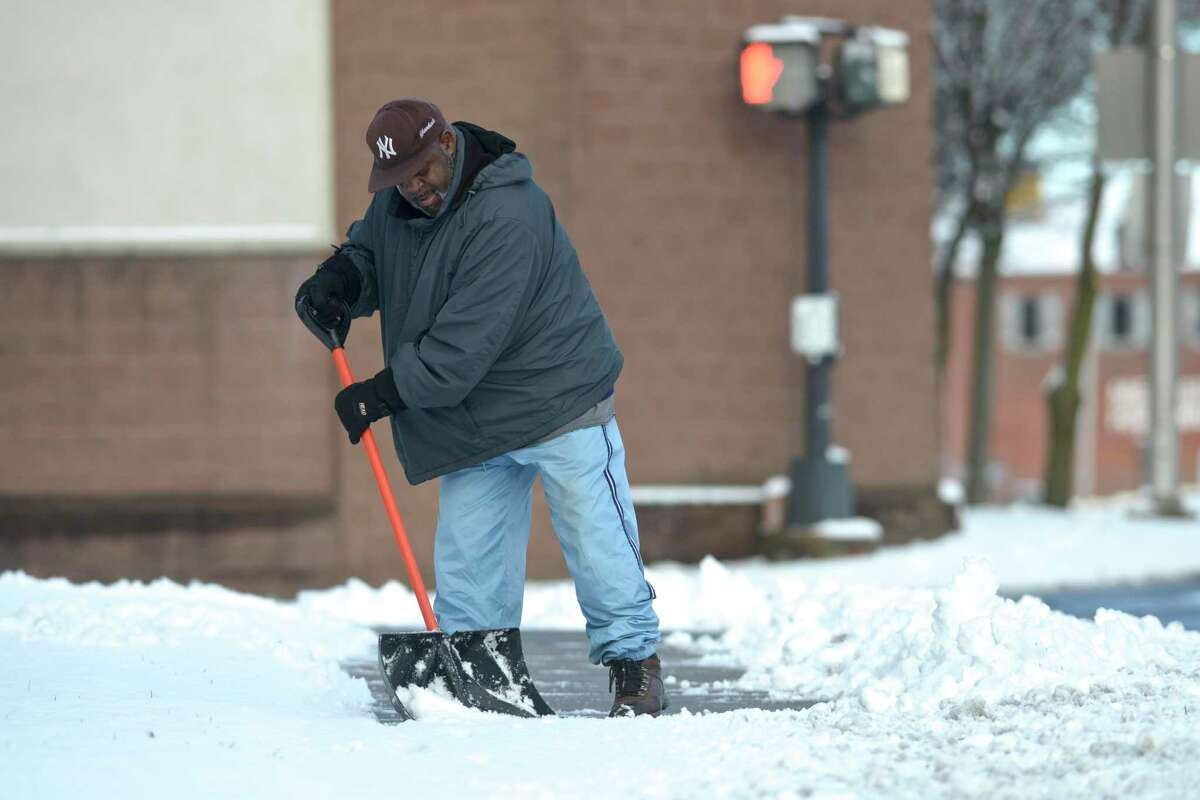 Joseph Jones, a member of New Bethel Church of God in Christ on Liberty Street, shovels the snow from the sidewalks around the church on Monday morning. January 4, 2021, in Danbury, Conn. Danbury has a mostly cloudy forecast for Monday, with a high near 40 degrees and winds between 3 and 6 mph. Temperatures are expected to drop to 29 degrees Monday night with light wind conditions.