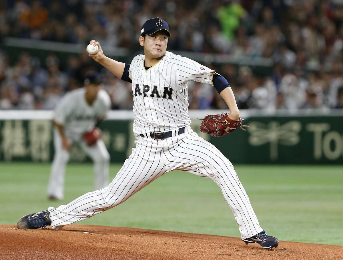 Japanese starting pitcher Tomoyuki Sugano throws against Cuba batter during a second-round game at the 2017 World Baseball Classic in Tokyo. The star pitcher has been posted by the Yomiuri Giants, with the MLB bidding expected to end Thursday.