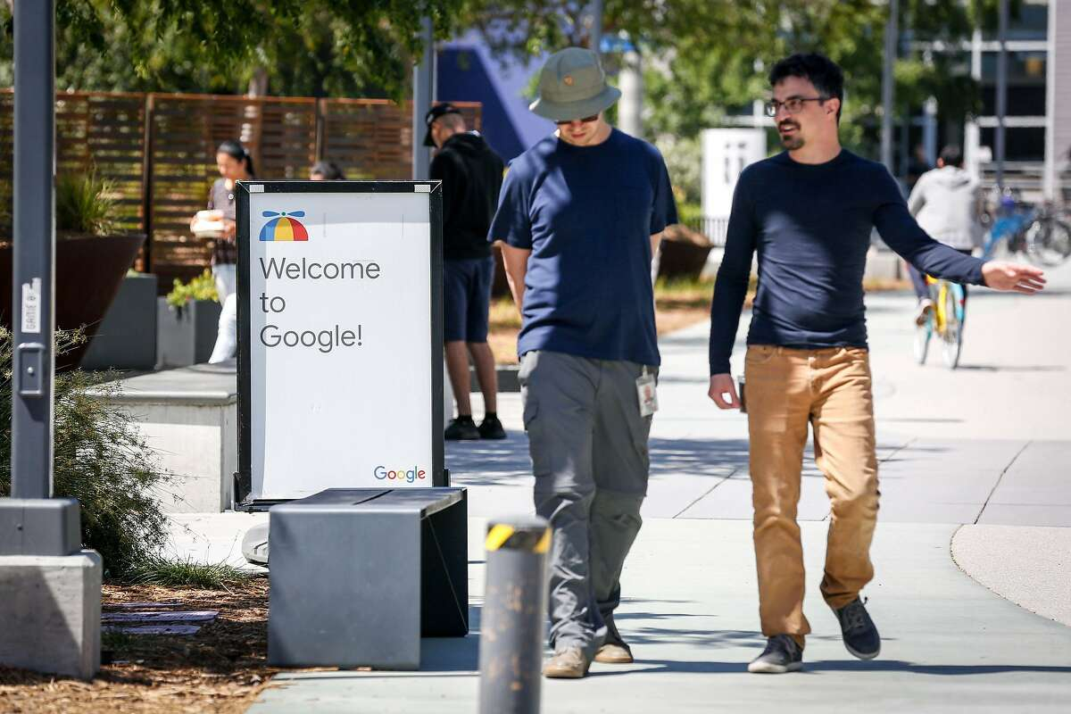 Employees walk on Google's main campus in 2019 as part of a protest against company policies. More than 200 employees at Alphabet, which is the parent company of Google, announced plans to form a union.