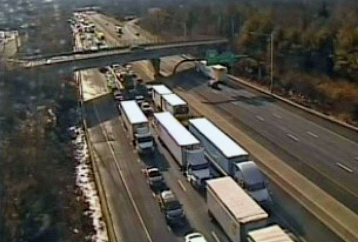 Traffic approaching the area of a crash on I-84 in Southington, Conn., on Monday, Jan. 4, 2021.