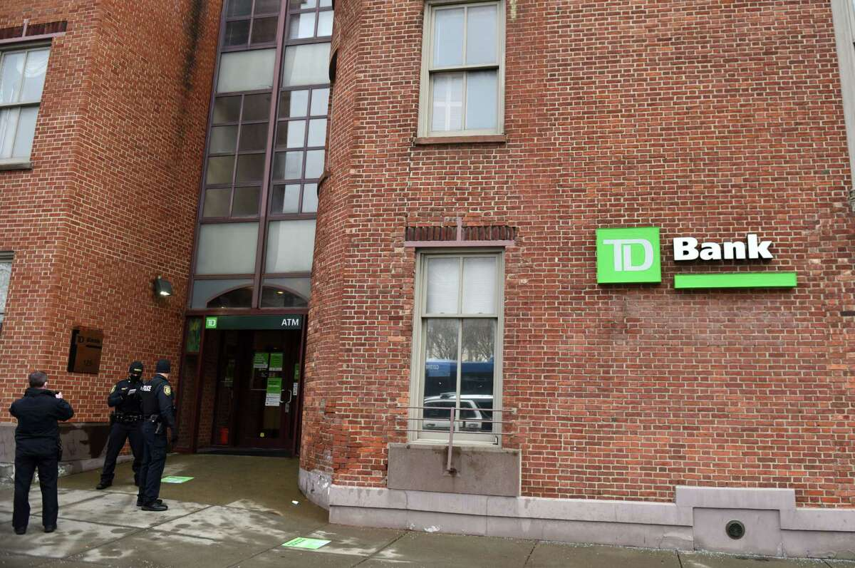 Albany police respond to a bank robbery at the TD Bank branch on Eagle Street adjacent Albany City Hall and the Capitol on Monday, Jan. 4, 2021, in Albany, N.Y. (Will Waldron/Times Union)