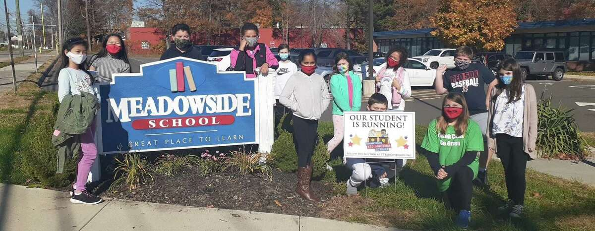 Meadowside 5th-graders show their support for their elected representative Cora Aitkenhead for a position as Connecticut's Kid Governor.