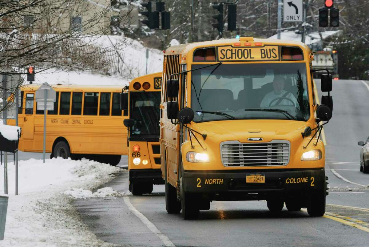 School buses are driven out onto Watervliet Shaker Rd. after leaving Shaker High School on Monday, Jan. 4, 2021, in Colonie, N.Y.(Paul Buckowski/Times Union)