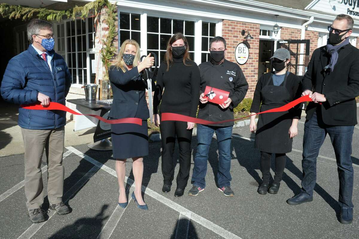 First Selectwoman Brenda Kupchick joins BE Chocolat owners Sylvie Fortin and Benoit Racquet and others for a ribbon cutting in front of the new store and workshop in Fairfield, Conn. Jan. 4, 2021.