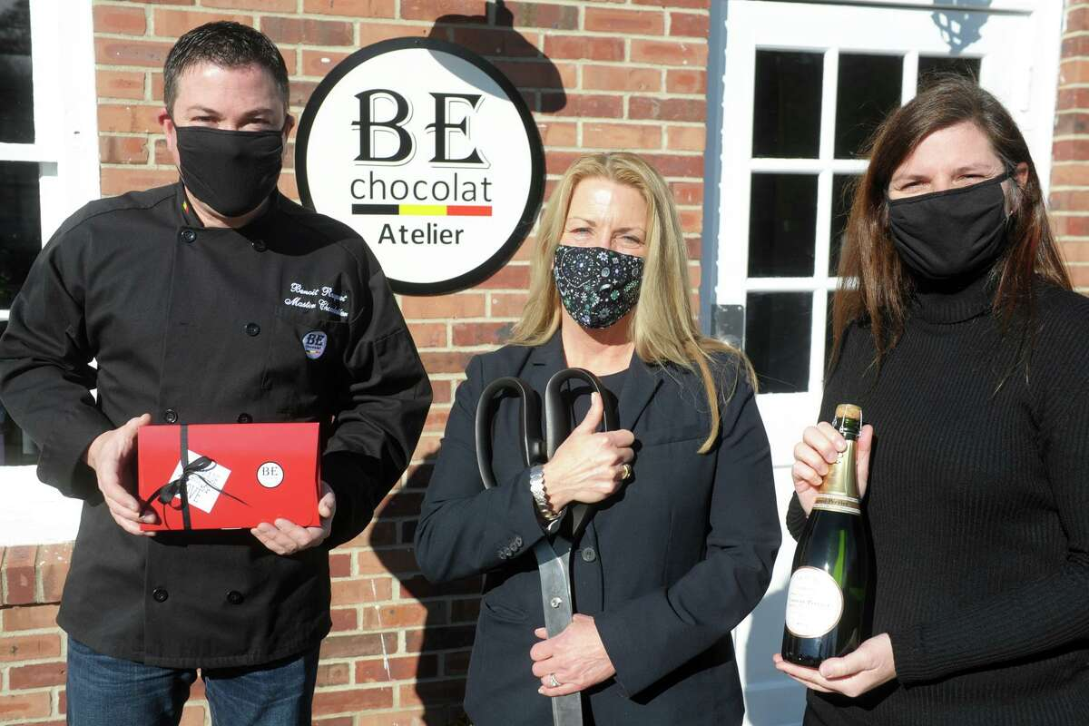 First Selectwoman Brenda Kupchick joins BE Chocolat owners Benoit Racquet and Sylvie Fortin for a ribbon cutting in front of the new store and workshop in Fairfield, Conn. Jan. 4, 2021.