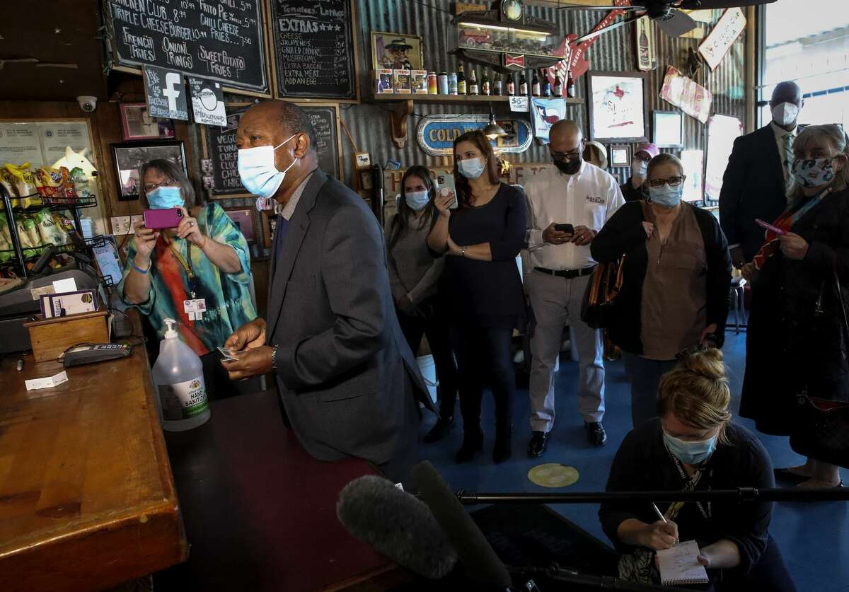 Houston Mayor Sylvester Turner orders food Monday, Jan. 4, 2021, at Miller's Cafe in Houston.