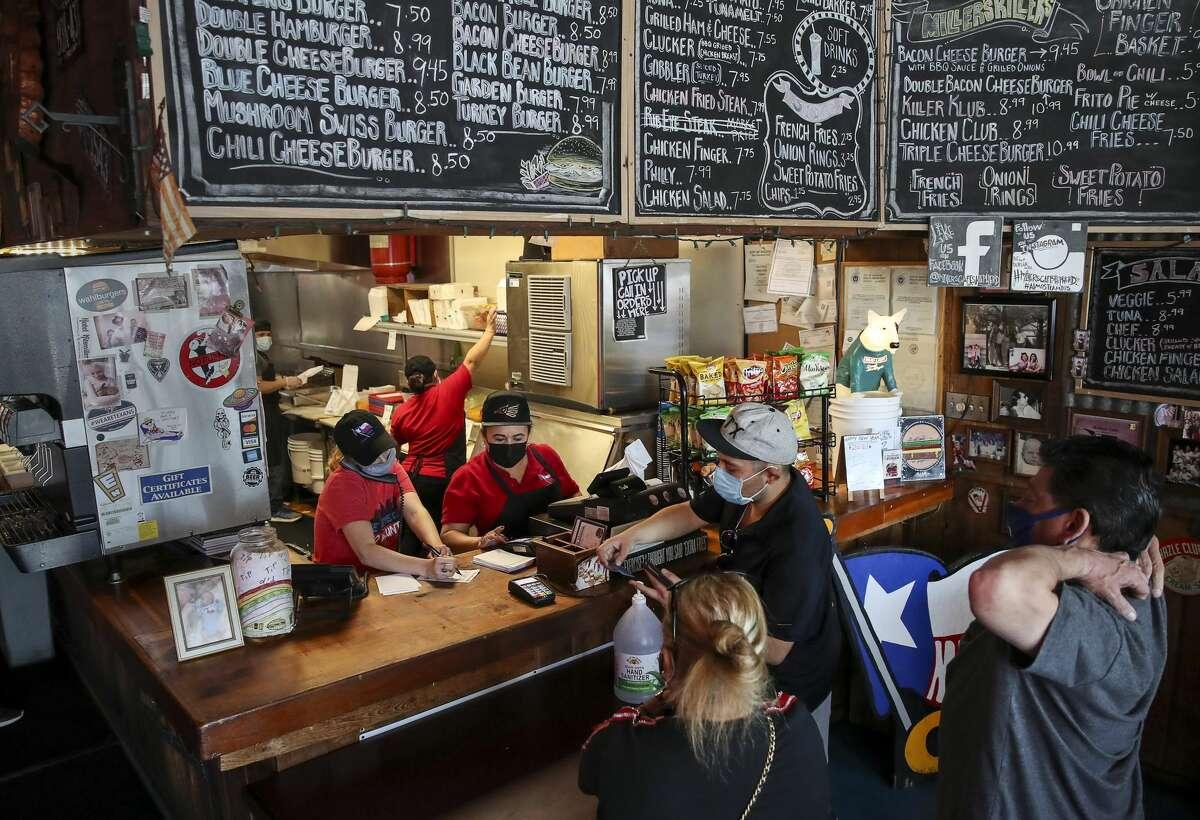 People order food Monday, Jan. 4, 2021, at Miller's Cafe in Houston.