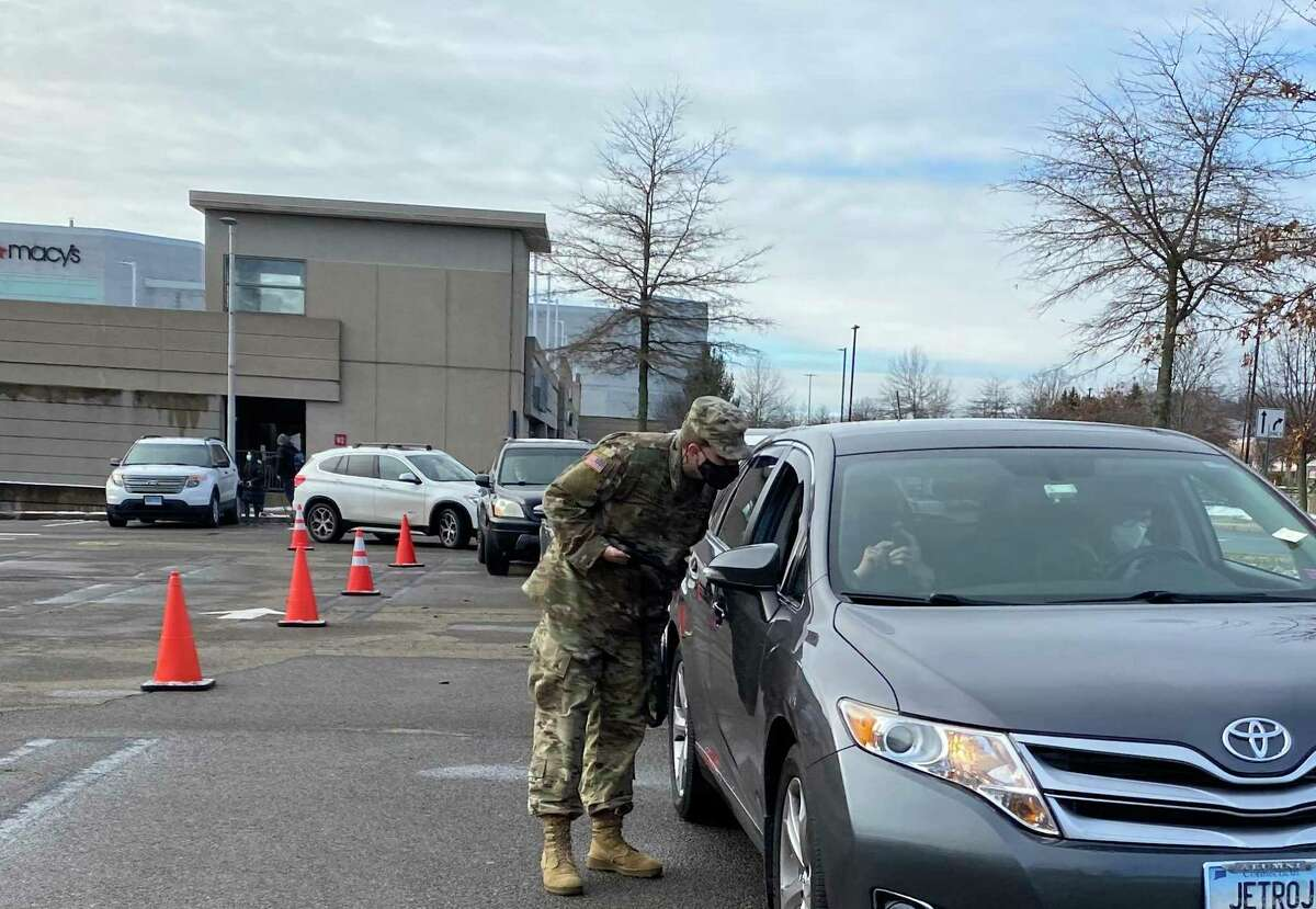 A National Guard solider registers a patient at the new COVID-19 test center at Milford's Connecticut Post mall Monday, Jan. 4, 2021.