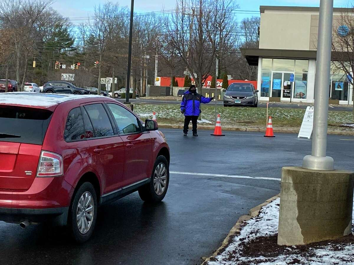 Traffic exits the Community Health Center's COVID-19 test center at Milford's Connecticut Post mall. The center administers about 300 tests per day, Monday through Friday.