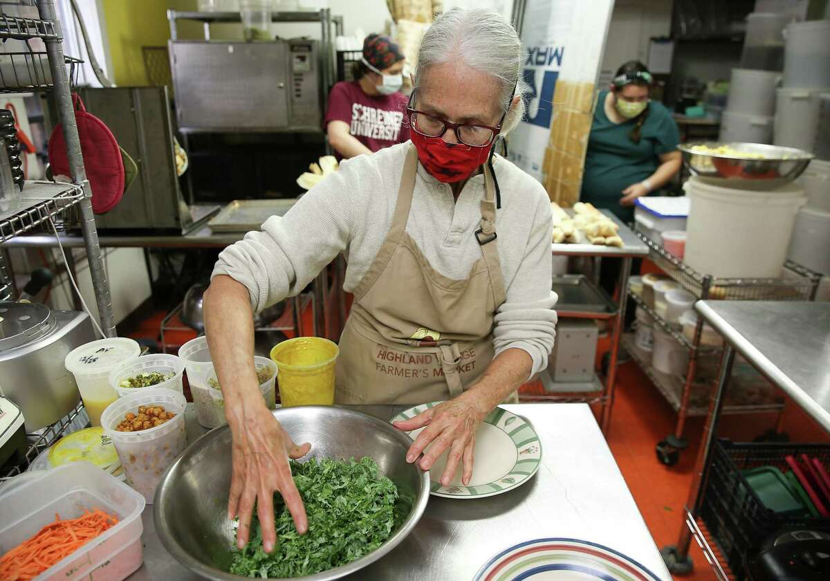 Pat Greer makes her Buddha Bowl made with chickpeas, quinoa, kale, carrots and broccoli in Houston on Wednesday, Dec. 30, 2020.