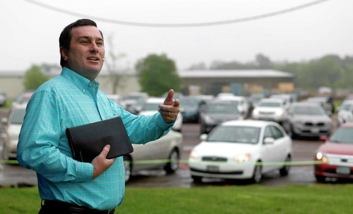 Pastor Chris Gober preaches during a drive-in style service at First Montgomery Baptist Church, Sunday, March 22, 2020, in Montgomery. More than 200 parishioners attended the service.