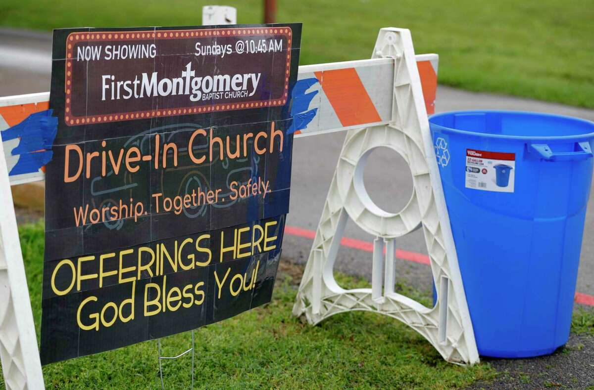 A sign for a drive-in-style service at First Montgomery Baptist Church in Montgomery is shown in March. The church's Bible study classes returned in several different formats in August.
