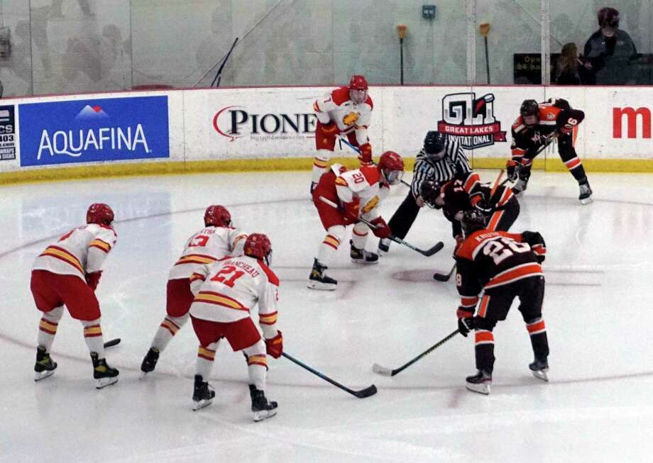 Members of Ferris State and Bowling Green's hockey team prepare for a faceoff during Sunday's game at Ewigleben Ice Arena. (Pioneer photo/Joe Judd)