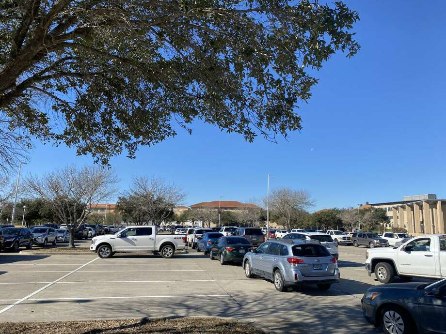 Those who made it into the city's COVID-19 vaccination clinic on Monday were led through Texas A&M International University, their cars snaked through parking lots in the order in which they drove in, single file. Photo: Julia Wallace /Laredo Morning Times