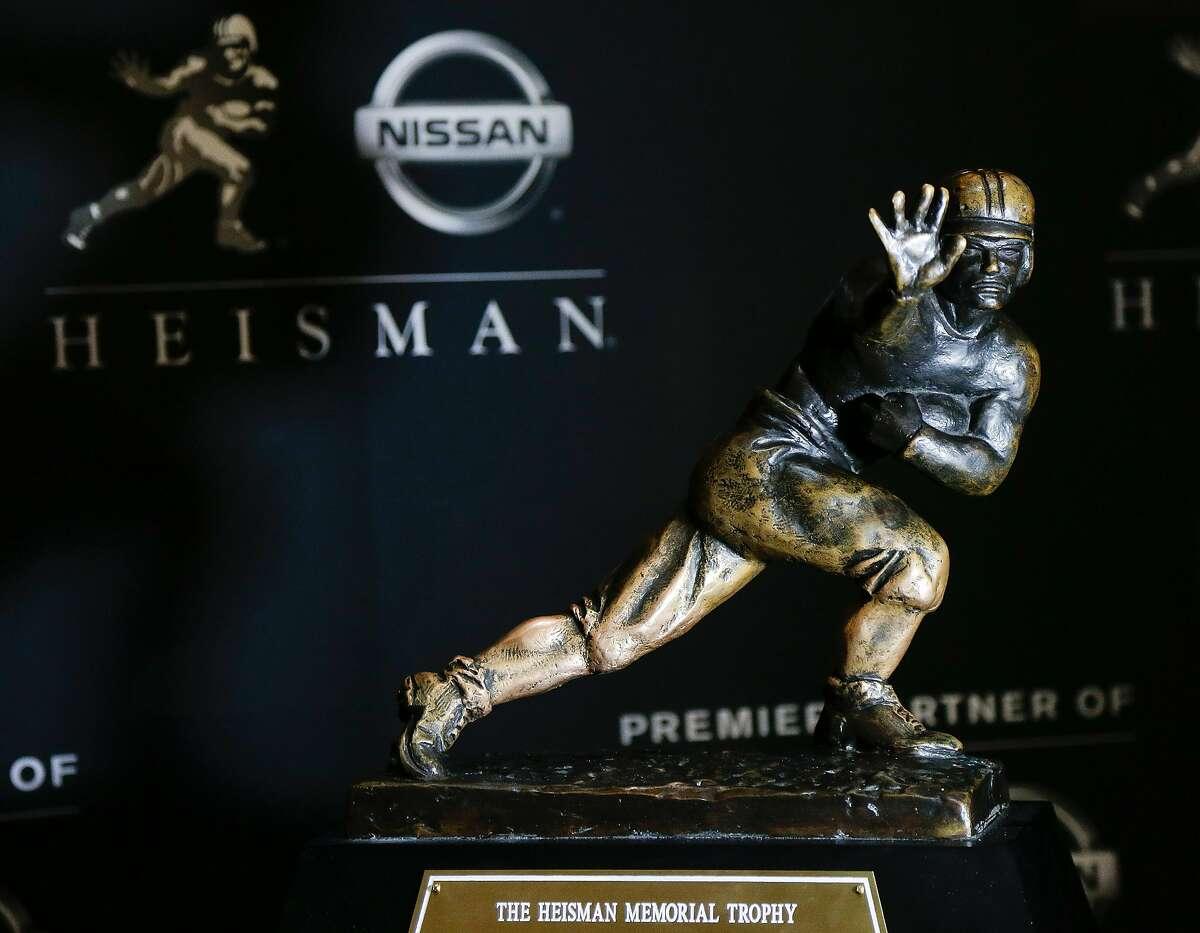 Alabama QB Mac Jones, Clemson QB Trevor Lawrence, Alabama receiver DeVonta Smith and Florida QB Kyle Trask are Heisman Trophy finalists. The trophy presentation is at 4 p.m. Tuesday (ESPN).