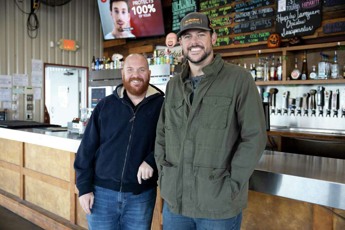 Deacon Baldy's Bar & Food Trucks general manager Joey Muckenthaler, left and president Kevin Mims, right, pose for a portrait in front of their bar, Thursday, Oct. 30, 2020, in Magnolia. The bar has been significantly impacted by COVID-19 where they've lost upwards of 40% of their typical annual revenue.
