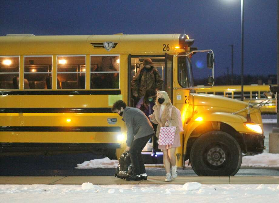 Students step off a bus at Manistee Middle/High School Monday for their first day of in-person learning since Nov. 20. Students of Manistee Area Public Schools, CASMAN Academy, Kaleva Norman Dickson and Onekama Consolidated Schools returned to in-person learning after closing out 2020 with all virtual learning. Photo: Kyle Kotecki/News Advocate