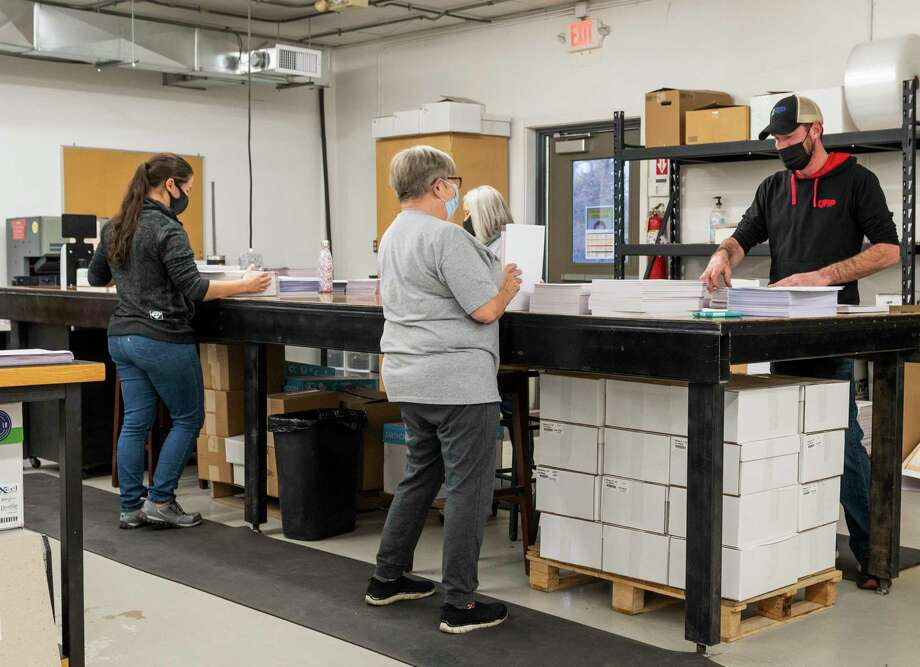 Employees at Quick Reliable Printing work in the newly remodeled their production location Wednesday, Dec. 30, 2020 at 3000 James Savage Rd. in Midland. (Adam Ferman/for the Daily News)