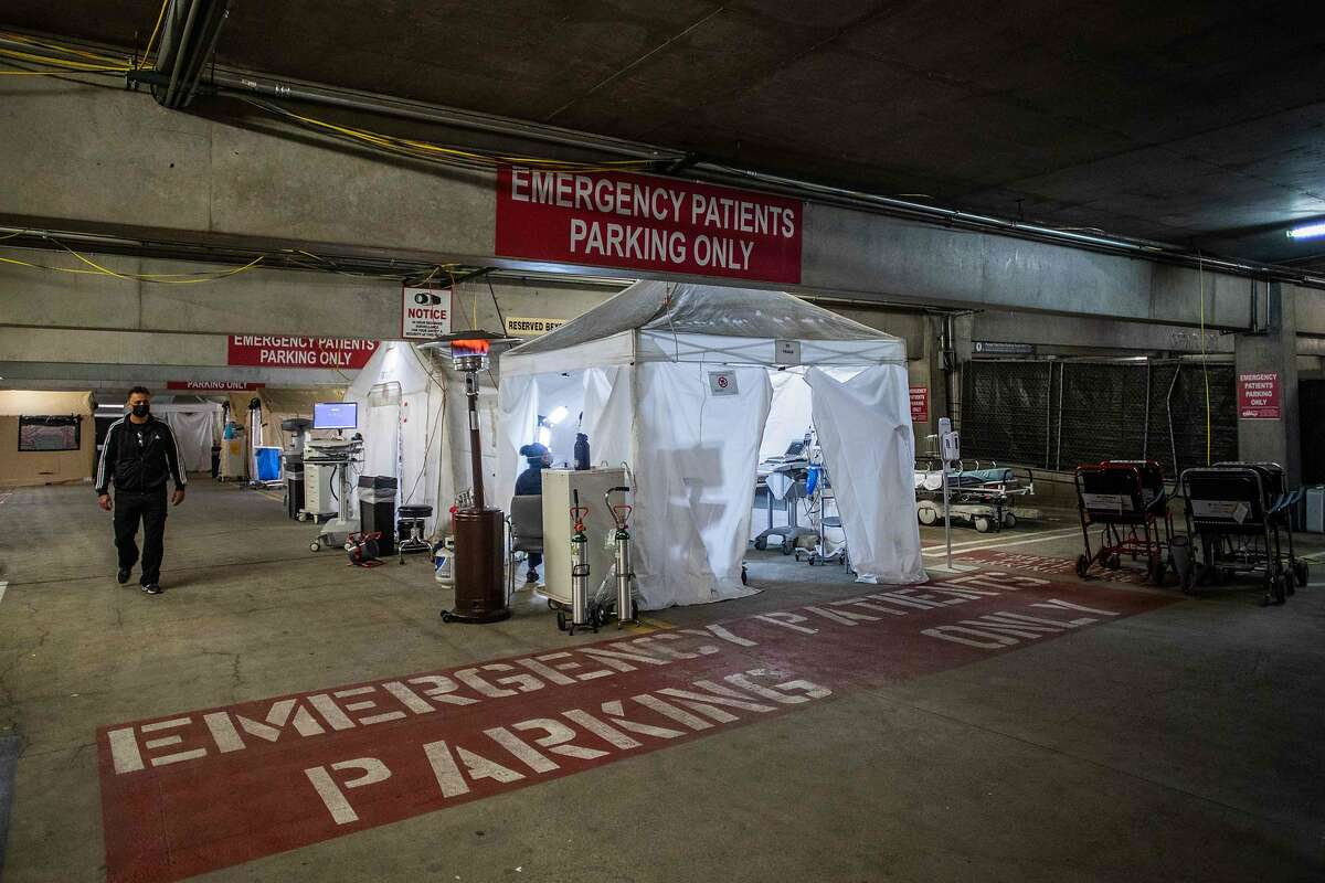 A temporary emergency room is set up in a parking garage at Providence Cedars-Sinai Tarzana Medical Center in Los Angeles.