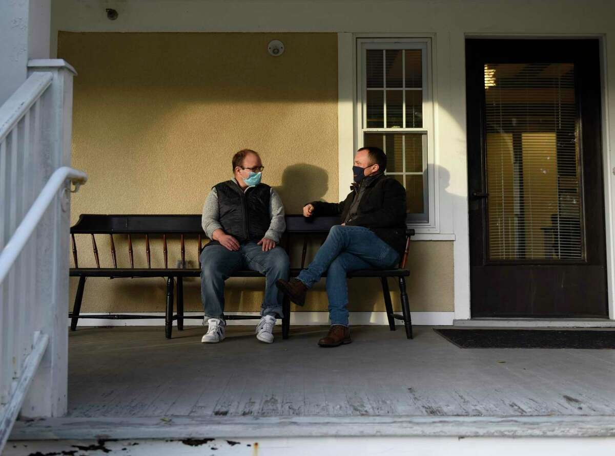 Pathways President Tom Athan, right, and his brother, Alex Athan, a Pathways client, chat outside the Pathways supported living apartments in Greenwich.