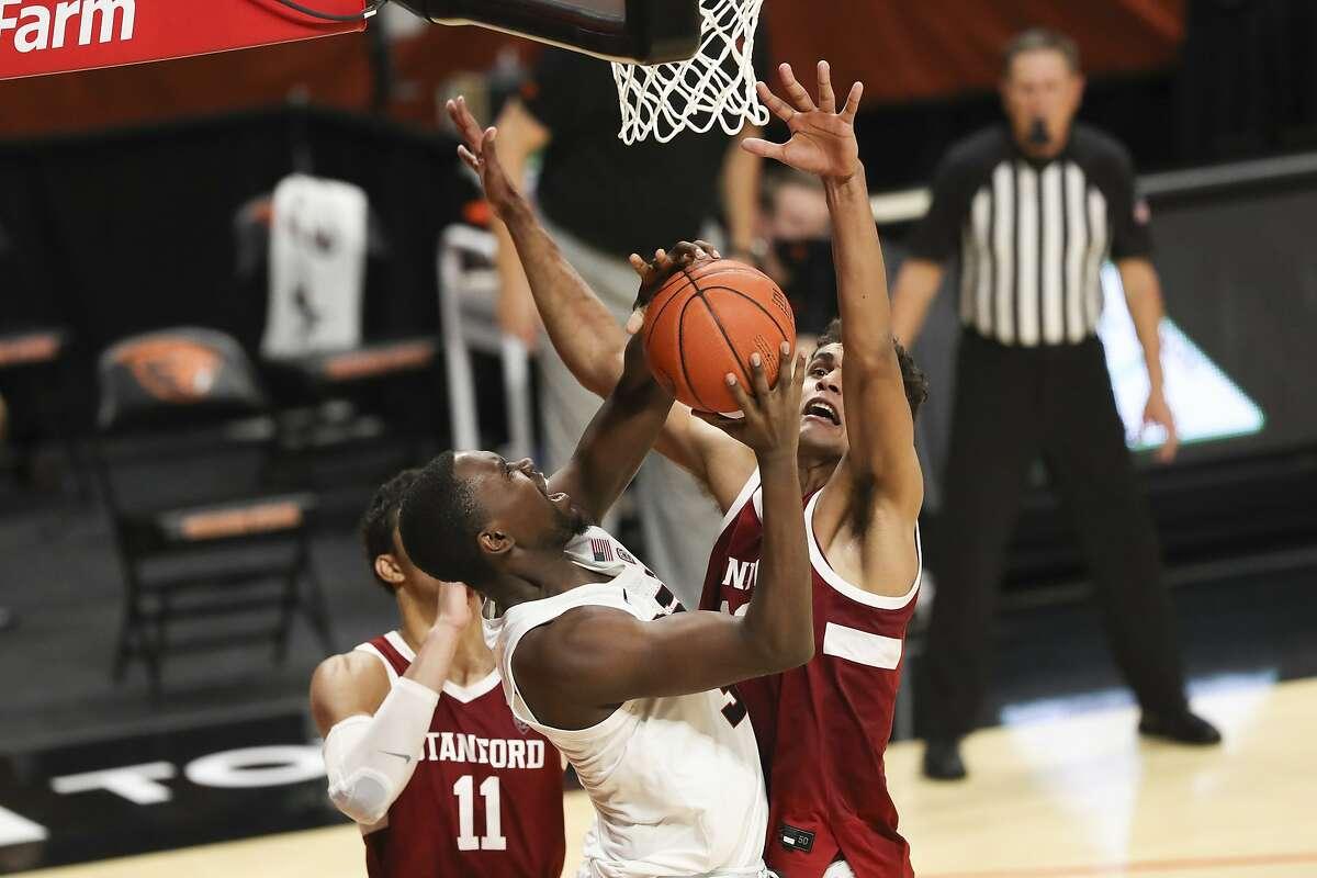 Stanford's Oscar da Silva (right) blocks a shot by Oregon State's Dearon Tucker. Da Silva scored a game-high 31 points.