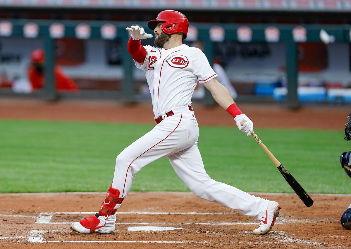 CINCINNATI, OH - SEPTEMBER 22: Curt Casali #12 of the Cincinnati Reds bats during the game against the Milwaukee Brewers at Great American Ball Park on September 22, 2020 in Cincinnati, Ohio. (Photo by Michael Hickey/Getty Images)