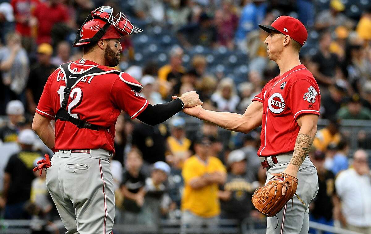 PITTSBURGH, PA - SEPTEMBER 29: Michael Lorenzen #21 of the Cincinnati Reds celebrates with Curt Casali #12 after the final out in a 3-1 win over the Pittsburgh Pirates at PNC Park on September 29, 2019 in Pittsburgh, Pennsylvania. (Photo by Justin Berl/Getty Images)