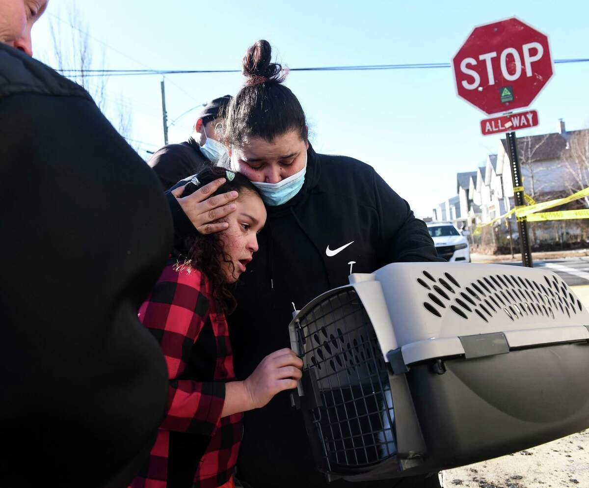 Vanessa Torres comforts her daughter, Sophia Ruiz, 7, after the family's cat, Moo Moo, was retrieved from a multi-unit home at 151 Saltonstall Avenue in New Haven on January 4, 2021 following a fire in the early morning hours.