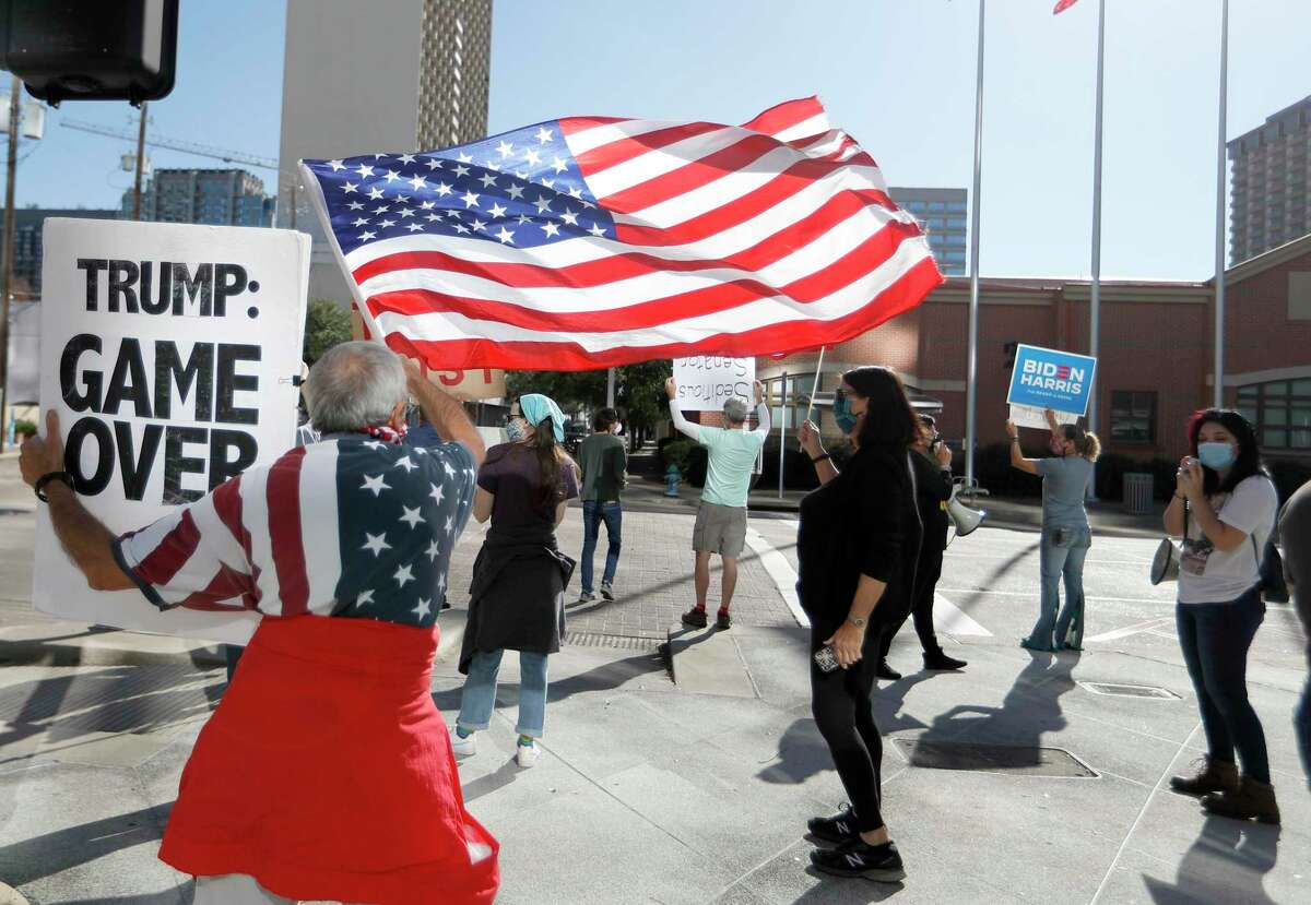 Members of the Protect The Results coalition hold a protest against Ted Cruz, Monday, Jan. 4, 2021, at Mickey Leland Federal Building in Houston . The protest is an expression of concern from Houstonians that anti-democratic extremists, led in part by Ted Cruz, believe in overturning the outcome of the 2020 election.