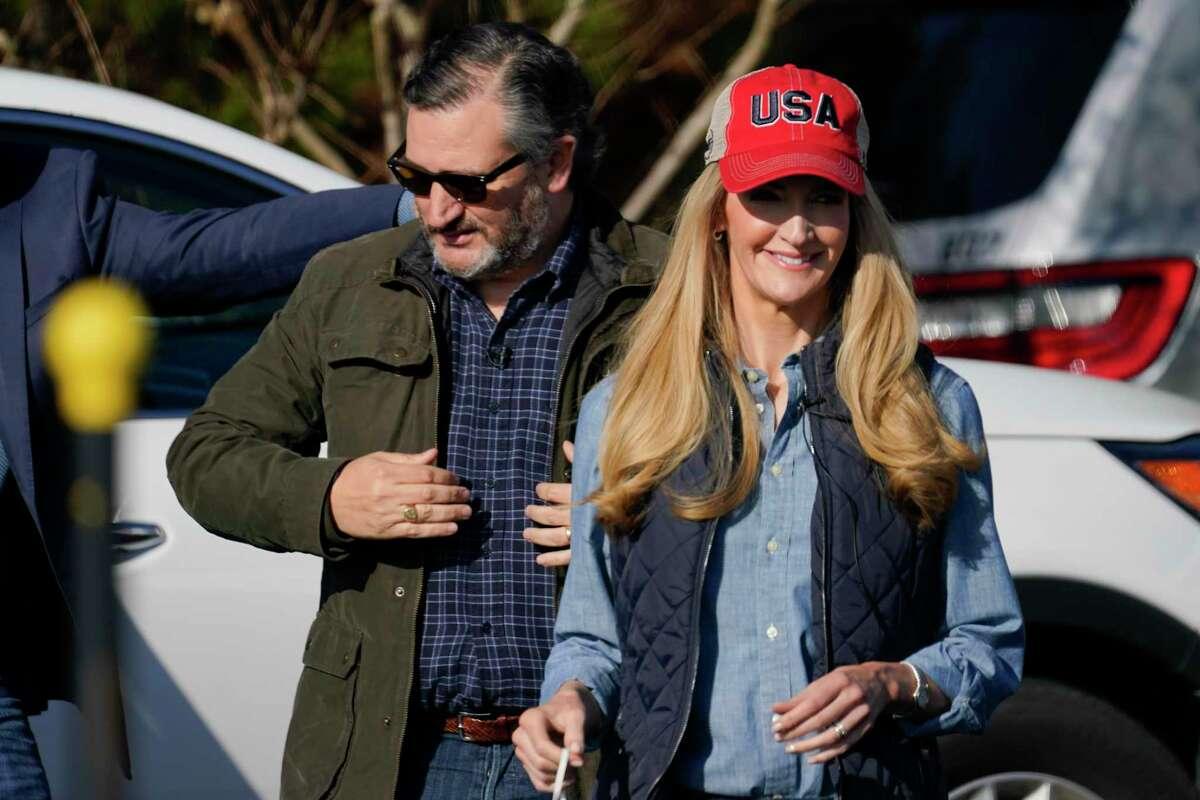 Sen. Kelly Loeffler, R-Ga., arrives with Sen. Ted Cruz, R-Texas, during a campaign rally on Saturday, Jan. 2, 2021, in Cumming, Ga. (AP Photo/Brynn Anderson)