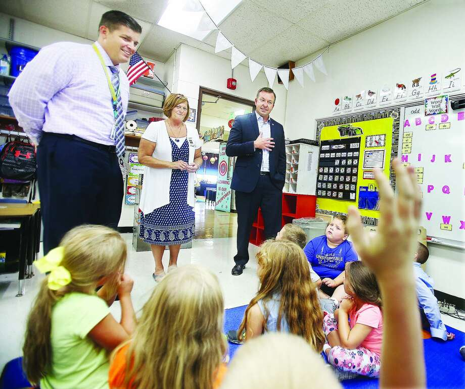 Sen. Andy Manar (right), D-Bunker Hill, visits a first-grade classroom last year at Brighton North Primary School with school Principal Diane Milnor (center) and superintendent Brad Skertich. Photo: John Badman| Hearst Illinois