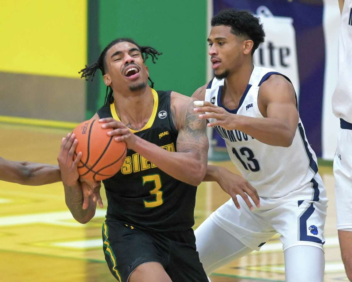 Siena College senior Manny Camper makes a move in front of Monmouth University senior Marcus McClary during a Metro Atlantic Athletic Conference game at the Siena College Alumni Recreation Center in Loudonville, NY, on Monday, Jan. 4, 2020 (Jim Franco/special to the Times Union.)