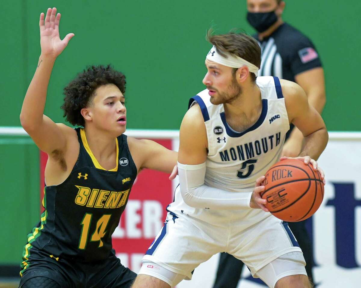 Siena College sophomore Jordan King defends Monmouth University senior George Papas during a Metro Atlantic Athletic Conference game at the Siena College Alumni Recreation Center in Loudonville, NY, on Monday, Jan. 4, 2020 (Jim Franco/special to the Times Union.)