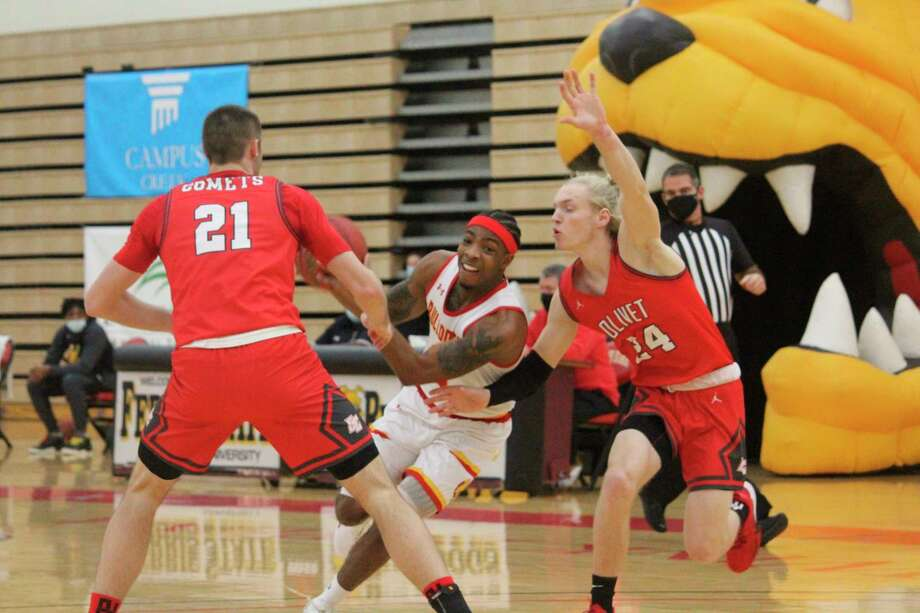 Former Crossroads Charter Academy All-Stater Britton Angell (right) tries to defend Ferris' Walt Kelser last Wednesday during a nonleague men's basketball game at FSU. (Pioneer photo/John Raffel)